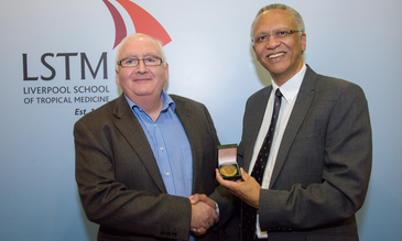 Professor Steve Ward (left) presents the Leverhulme Medal to Professor Jimmy Volmink