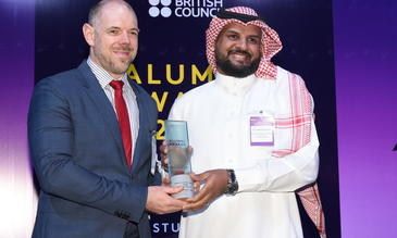 Dr Waleed receiving the award from deputy ambassador Mr Richard Oppenheim
