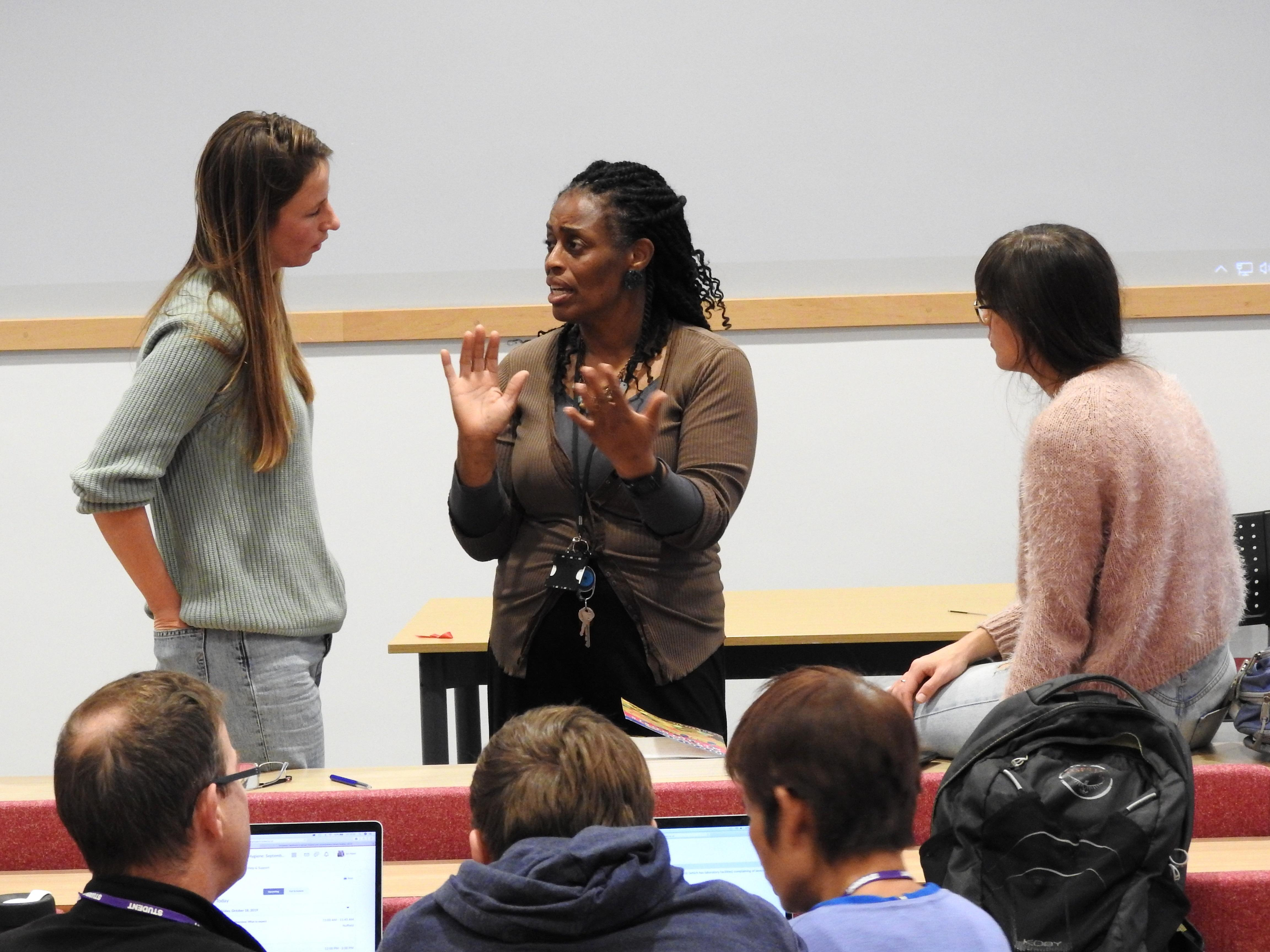 Dr Angela Obasi talking to LSTM students