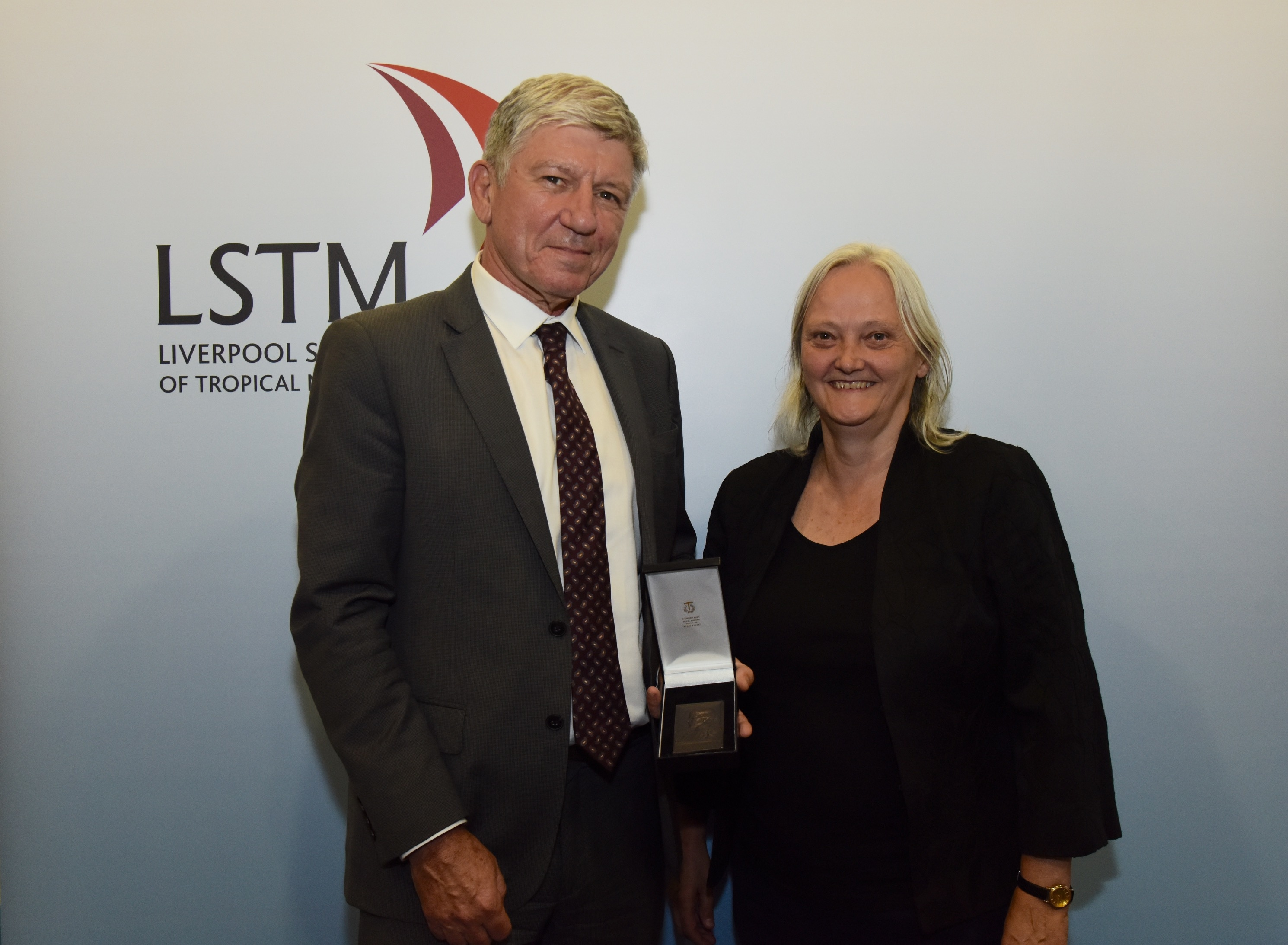 Professor Kevin Marsh receives the Kingsley medal from LSTM Director, Professor Janet Hemingway