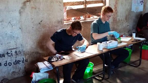 LSTM students, Angus More O'Ferrall and Hamish Baxter, doing their research in Malawi